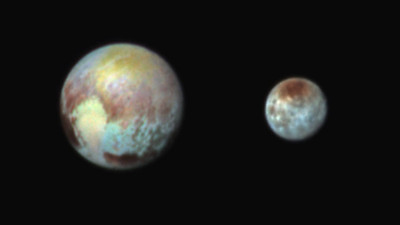 Pluto and Charon in False Color Show Compositional Diversity  This July 13, 2015, image of Pluto and Charon is presented in false colors to make differences in surface material and features easy to see. It was obtained by the Ralph instrument on NASA's New Horizons spacecraft, using three filters to obtain color information, which is exaggerated in the image. These are not the actual colors of Pluto and Charon, and the apparent distance between the two bodies has been reduced for this side-by-side view.  The image reveals that the bright heart-shaped region of Pluto includes areas that differ in color characteristics. The western lobe, shaped like an ice-cream cone, appears peach color in this image. A mottled area on the right (east) appears bluish. Even within Pluto's northern polar cap, in the upper part of the image, various shades of yellow-orange indicate subtle compositional differences.  The surface of Charon is viewed using the same exaggerated color. The red on the dark northern polar cap of Charon is attributed to hydrocarbon materials including a class of chemical compounds called tholins. The mottled colors at lower latitudes point to the diversity of terrains on Charon.  This image was taken at 3:38 a.m. EDT on July 13, one day before New Horizons' closest approach to Pluto.  NASA/Johns Hopkins University Applied Physics Laboratory/Southwest Research Institute